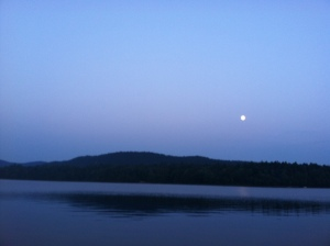moon rising over lake