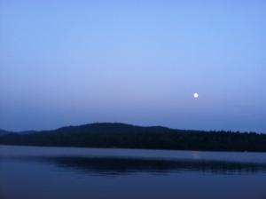 moon rising over lake